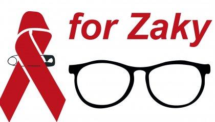 Un nastro rosso per Zaky: l'abbraccio dell'Alma Mater Non solo puntato sul petto